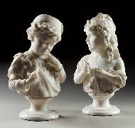 Two busts of a young boy and a girl